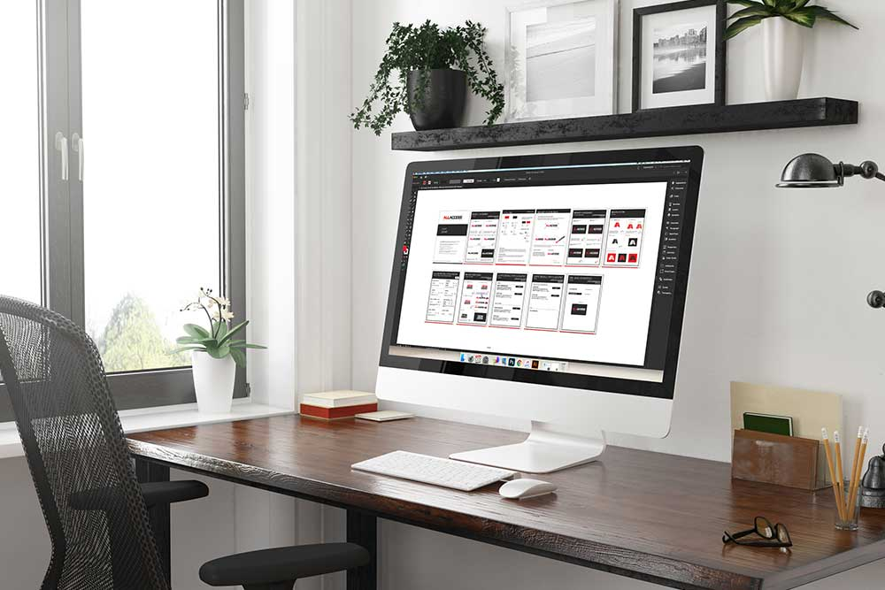 computer on desk with brand guidelines